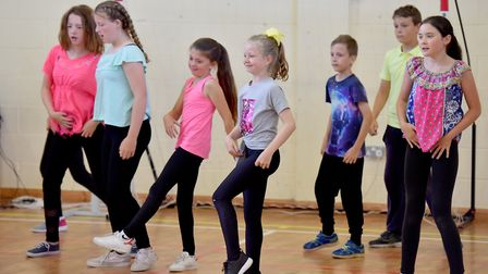 Woods Loke Primary School children perform a dance show as part of the school's 'Attiude' festival.P