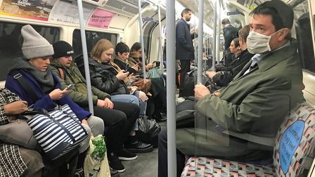 A man on the London Underground wearing a protective facemask. Picture: PA