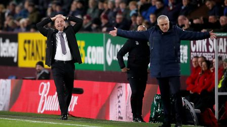 Burnley manager Sean Dyche (left) and Tottenham boss Jose Mourinho react on the touchline during the