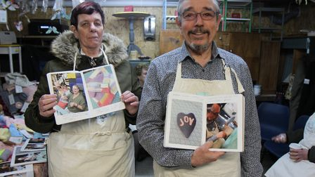 Silver Linings volunteers Remo Mongiat and Diane Saunders showing off their craft books. Diane says