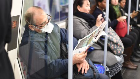 A man on the Jubilee line wearing a protective facemask. Picture: Kirsty O'Connor/PA Wire