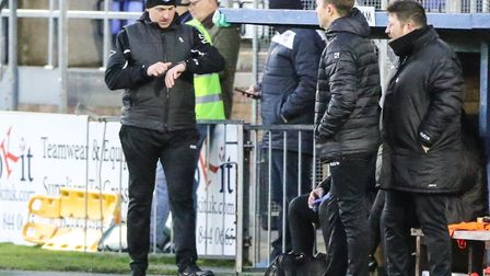 Wingate & Finchley manager Spencer Knight looks down at his watch (Pic: Martin Addison)