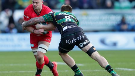 Saracens Ben Earl is tackled by Northampton's Teimana Harrison