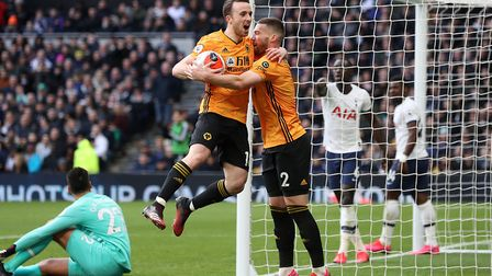 Wolverhampton Wanderers' Diogo Jota (left) celebrates scoring his side's second goal of the game wit