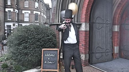 St Luke's vicar Reverend Jon March in Victorian attire welcoming guests. Picture: Frank Docherty