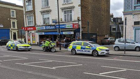 Police at the scene in Stoke Newington Road. Picture: Supplied
