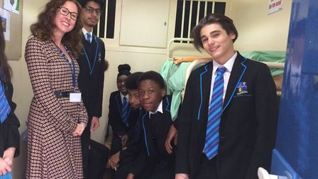 Principal Clare Borrill and students inside the prison cell. Picture: Petchey Academy