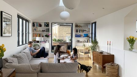 Richard Keep and his daughters in the living space, which forms part of the two zinc boxes on the ne