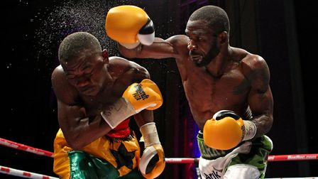 Larry Ekundayo (green/white shorts) fighting Joseph Lamptey in 2015. Pic: Gavin Ellis/TGS Photo