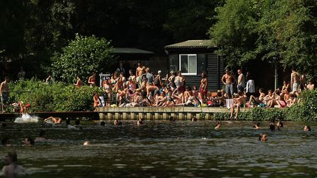 Swimmers enjoying the mixed bathing pond on Hampstead Heath. Picture: PA IMAGES