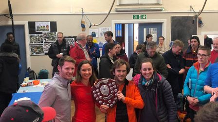 Highgate Harriers captains celebrate with the Howard Williams Trophy as overall winners of the Met L