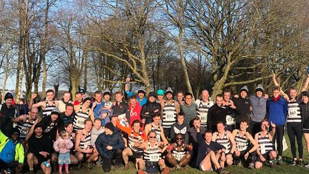 Highgate Harriers men celebrate their Met League title double, with captain Rob Wilson (front row, c