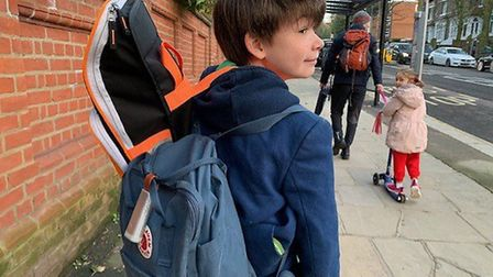 Jacob Trimble tests a Plume air quality monitor on his way to school in Hampstead. Picture: Elaine T