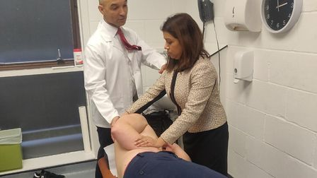 Hampstead and Kilburn Labour MP Tulip Siddiq tries out giving a massage. Picture: BCOM