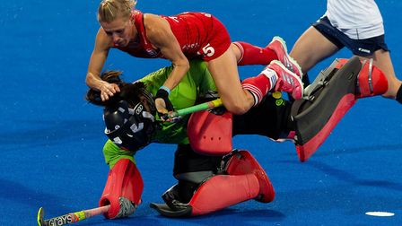England's Alex Danson collides with South Korea's A Hyeon Hwang during the Vitality Women's Hockey W