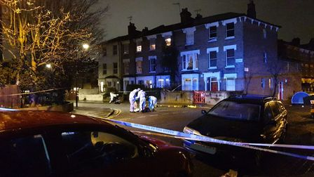 Police at the scene of the stabbing in Clapton. Picture: @999London