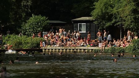 Swimmers enjoying the mixed bathing ponds of Hampstead Heath. Picture: PA