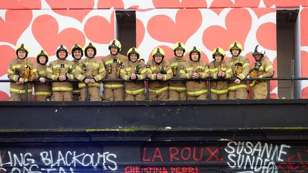 LFB crew on the balcony of the Grade II listed building. Picture: David Parry/PA Wire