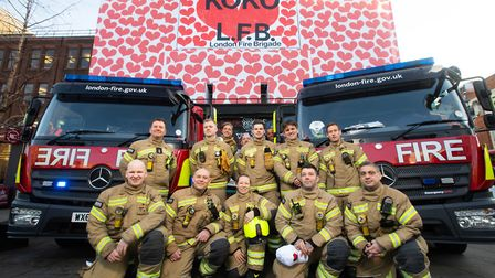 Firefighters outside the Valentine's Day artwork by graphic designer Richard Turle. Picture: David P
