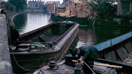 Boats turning at the Hertford Union Canal entrance having unloaded timber c.1965. Picture: London Ca