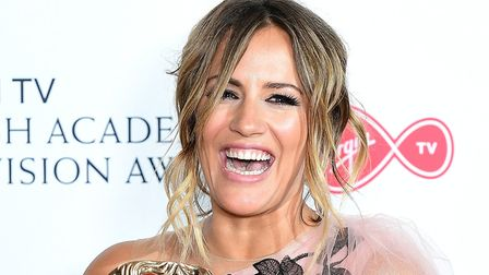 Caroline Flack with the reality and constructed factual award on behalf of Love Island at the Virgin
