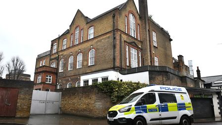 A police van parked outside the building believed to be where Caroline Flack lived in Clapton, Londo