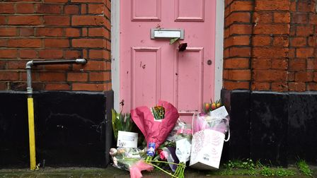 Floral tributes placed outside Caroline Flack's former home in North London. PA Photo. Picture: Domi
