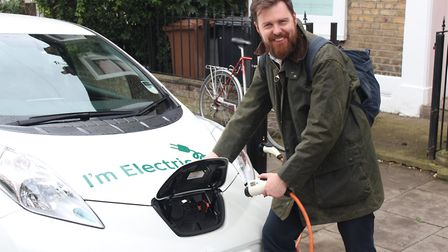 Cllr Jon Burke charges an electric vehicle. Picture: Hackney Council