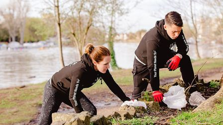 Dermot Kavanagh and Michelle Parkes in the midst of plogging. Picture: Annie Armitage / Plogolution