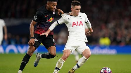 RB Leipzig's Christopher Nkunku (left) and Tottenham Hotspur's Giovani Lo Celso battle for the ball