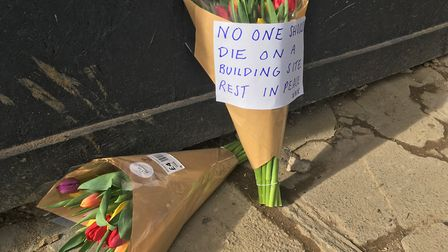 Flowers left for Stephen Hampton who died following a blast in Swain's Lane. Picture: Nathalie Raffr