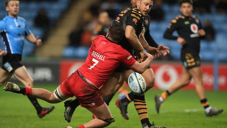Saracens' Sean Reffell tackles Wasps' Jimmy Gopperth during the Gallagher Premiership match at the R