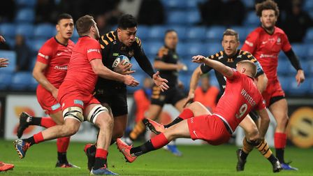 Saracens' Tom Whiteley is handed off by Wasps' Malakai Fekitoa during the Gallagher Premiership matc