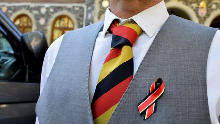 Campaigners in ties and ribbons, outside Church House, Westminster, as the preliminary hearings of