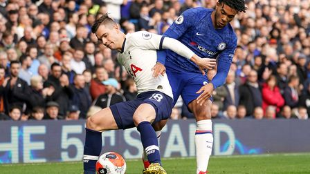 Tottenham Hotspur's Giovani Lo Celso (left) and Chelsea's Reece James battle for the ball during the
