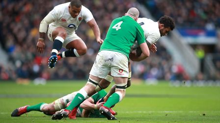 England's Courtney Lawes is tackled by Ireland's Devin Toner during the Guinness Six Nations match a