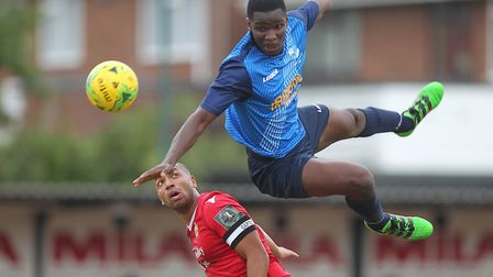 New Haringey signing Olu Oluwatimilehin (right) challenges for the ball while at Wingate & Finchley.