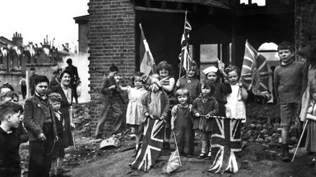 Young London residents celebrate VE Day, marking the end of the war in Europe. Picture: PA ARCHIVE