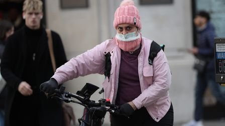 A woman wearing a face mask mask in central London. Picture: Yui Mok/PA Wire