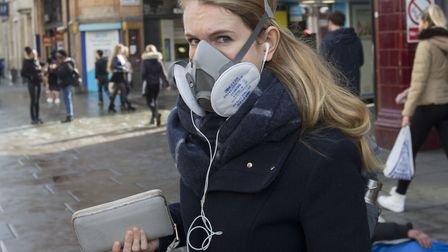 Stock image of woman wearing protective mask. Picture: Rick Findler/ PA