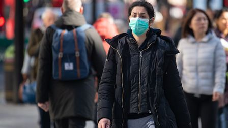 People wear masks while out in public during the coronavirus outbreak. Picture: Dominic Lipinski/PA