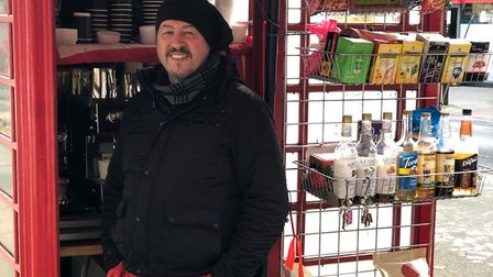 Mustafa Mehmet at his station in Hampstead's old-fashioned red phone box. Picture: Mustafa Mehmet