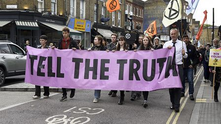 XR campaigners marched on Abney Park to mourn the loss of the Red Girdled Mining Bee there, followin