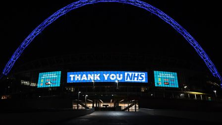 Wembley Arch is illuminated to show its appreciation to the NHS amid the coronavirus outbreak. Pictu