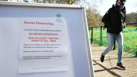 A sign from the Royak Parks notifying the public about social distancing. Picture: Jonathan Brady/ P