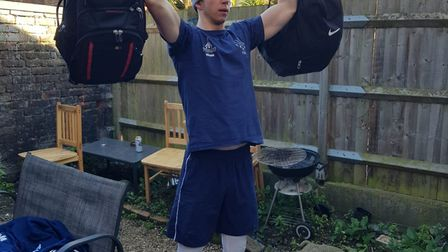 ZFW Fencing Club's Dominic de Almeida puts his university books and bags to good use during strength