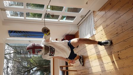 ZFW Fencing Club's Matthew Abrahams practices his lunge at home