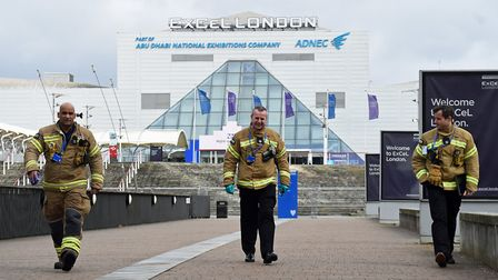 Members of the London Fire Brigade at the ExCel centre in London which is being made into a temporar