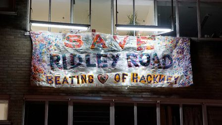 The Save Ridley Road banner hanging from the Ridley Road Shopping Village.