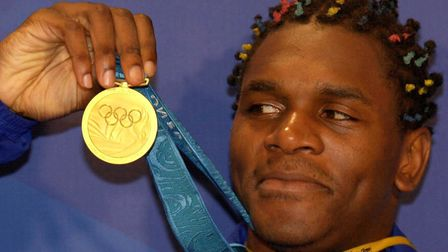 Great Britain's Audley Harrison celebrates winning gold after defeating Kazakhstan's Mukhtarkhan Dil